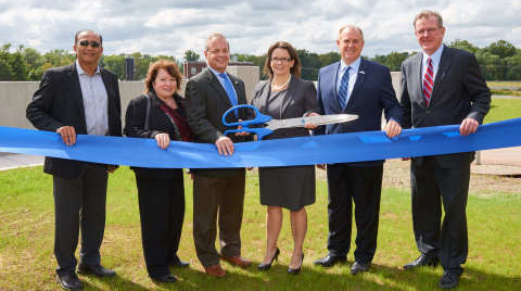 Members of the American Water New Jersey team celebrate the completion of a $37 million flood protection project, which will help ensure the continued protection and sustainability of water supply for more than 1 million residents.
